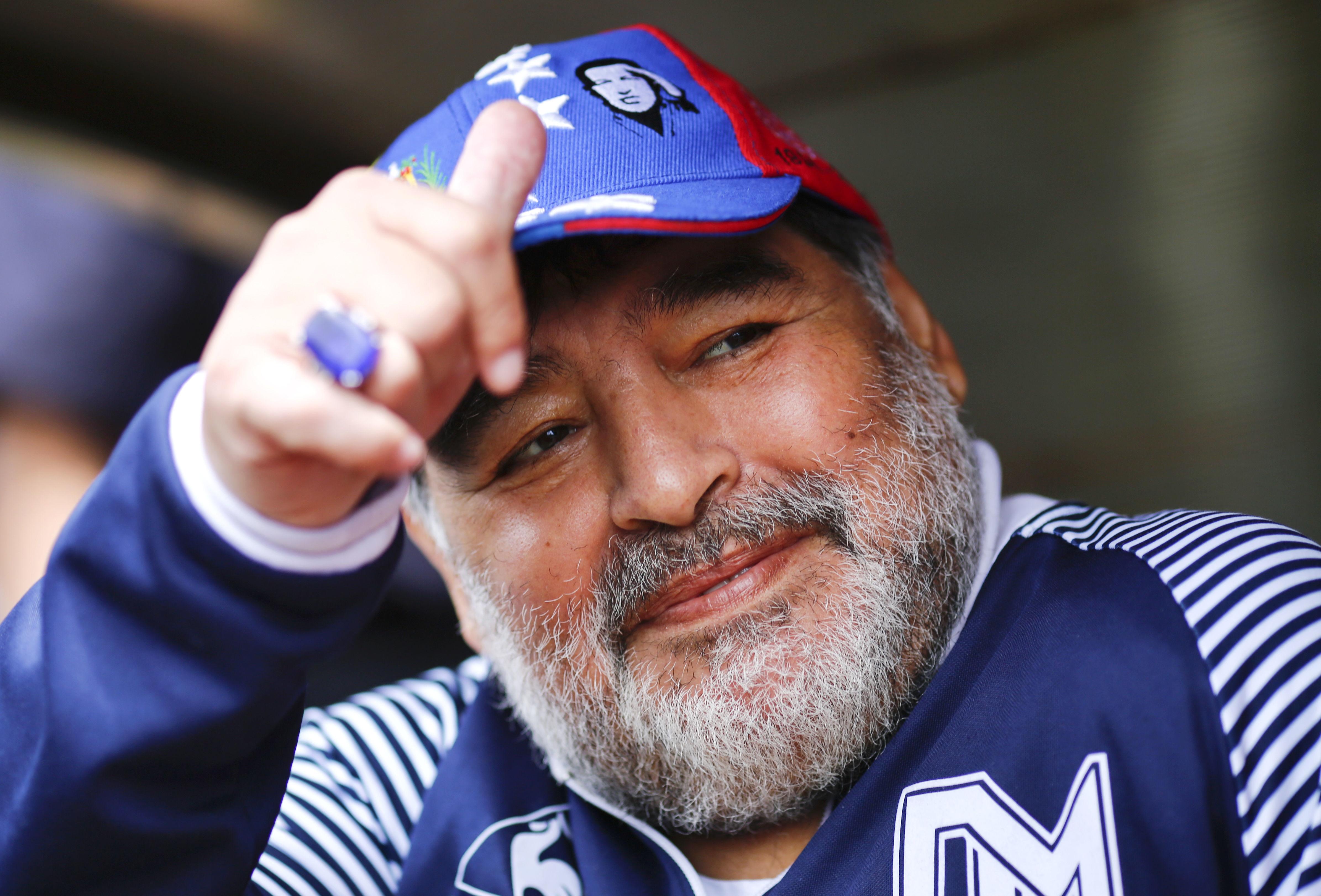 Символ футбола. ФОТО галерея памяти Диего Марадоны - фото 43