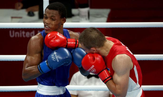 Это минимум бронза. Александр Хижняк вышел в полуфинал боксерского турнира Олимпиады - изображение 1